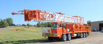 Service King Manufacturing SK 575 Carrier mount rig with 104 foot workover derrick. All around standard workhorse for oil and gas well servicing.